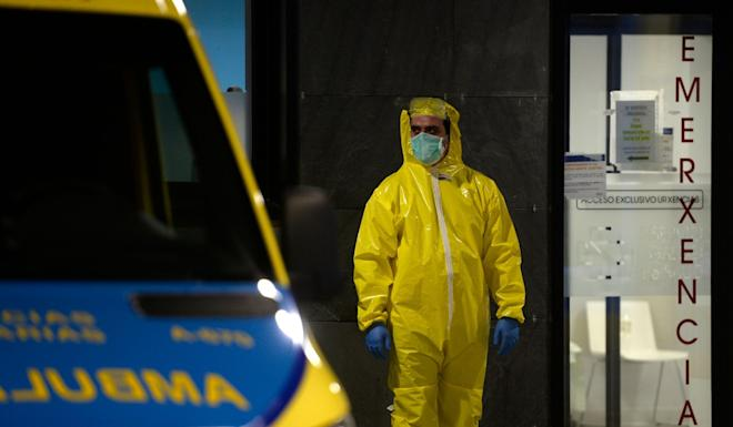 A paramedic in protective gear stands outside the Alvaro Cunqueiro hospital in Vigo, northwestern Spain. As the global death toll soared past 20,000, Spain joined Italy in seeing its number of fatalities overtake China. Photo: Agence France-Presse