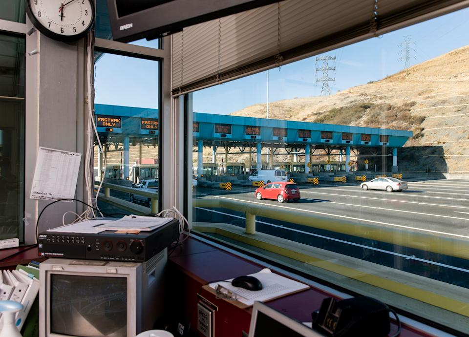 The Carquinez Bridge toll plaza in Vallejo, Calif., is empty of tollbooth collectors on July 30, the result of the state's decision to automate the jobs at the start of the COVID-19 pandemic. For now, workers are being paid in exchange for taking online courses in other fields, but that's not a benefit available to most of the millions of U.S. employees who have lost jobs during the pandemic. | Cayce Clifford for TIME