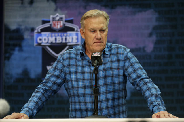 "FILE - In this Feb. 25, 2020 file photo Denver Broncos general manager John Elway speaks during a news conference at the NFL football scouting combine in Indianapolis. NFL teams are having to rely more heavily on game film of college prospects as they prepare for the draft at a time when the COVID-19 pandemic has halted business as usual. On Tuesday, March 31, 2020 Elway said in a conference call, ""We'll just have to conclude the best we can from what we can see on the tape."" (AP Photo/Michael Conroy)"