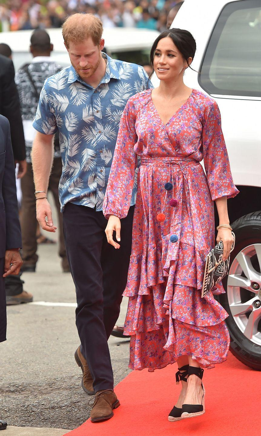<p>During her royal tour of Fiji with Prince Harry, Meghan selected this exuberant pink dress, complete with ruffles and pom-poms. </p>