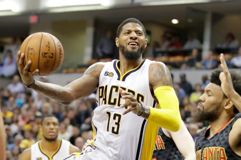 Paul George of the Indiana Pacers goes for a shot during their NBA game against the Atlanta Hawks, at Bankers Life Fieldhouse in Indianapolis, Indiana, on April 12, 2017