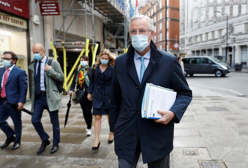 EU chief negotiator Michel Barnier wearing a protective mask leaves his hotel in London