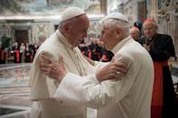 Former pope Benedict (R) is greeted by Pope Francis during a ceremony to mark his 65th anniversary of ordination to the priesthood at the Vatican June 28, 2016. Osservatore Romano/Handout via Reuters