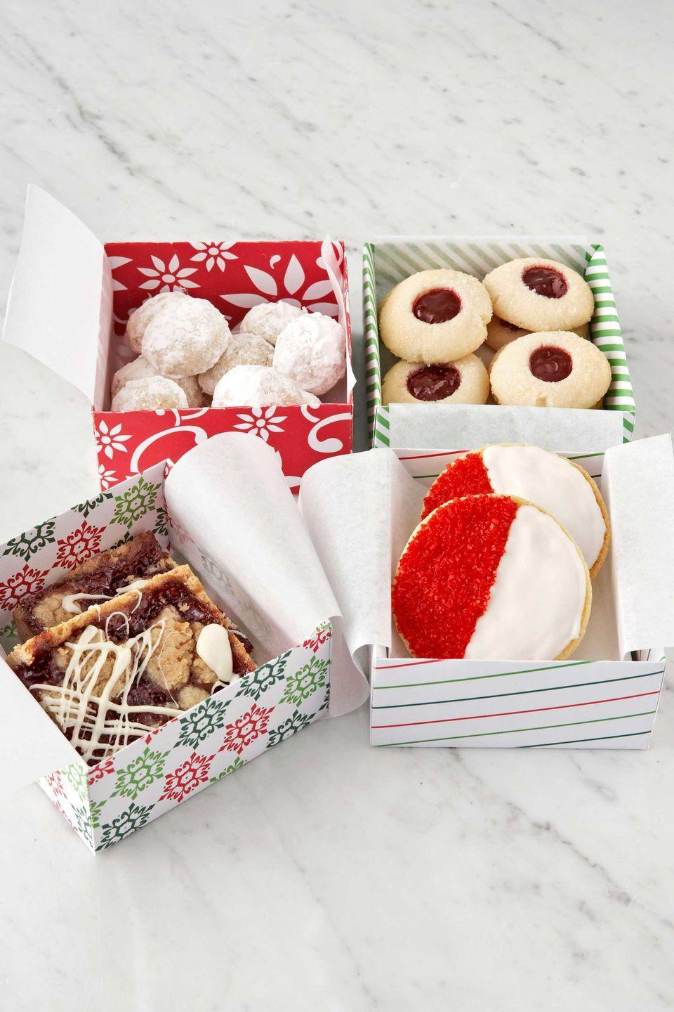 """<p>One tasty recipe yields four very different kinds of Christmas cookies. </p><p><strong>Recipes: </strong><a href=""""https://www.countryliving.com/food-drinks/recipes/a3306/tea-cookie-dough/"""" rel=""""nofollow noopener"""" target=""""_blank"""" data-ylk=""""slk:Tea Cookie Dough"""" class=""""link rapid-noclick-resp""""><strong>Tea Cookie Dough</strong></a></p><p><strong><a href=""""https://www.countryliving.com/food-drinks/recipes/a3272/roly-poly-cookie-recipe/"""" rel=""""nofollow noopener"""" target=""""_blank"""" data-ylk=""""slk:Roly Polys"""" class=""""link rapid-noclick-resp"""">Roly Polys</a> </strong></p><p><a href=""""https://www.countryliving.com/food-drinks/recipes/a3271/jam-thumbprints-recipe/"""" rel=""""nofollow noopener"""" target=""""_blank"""" data-ylk=""""slk:Jam Thumbprints"""" class=""""link rapid-noclick-resp""""><strong>Jam Thumbprints</strong></a></p><p><strong><a href=""""https://www.countryliving.com/food-drinks/recipes/a3267/red-and-white-cookie-recipe/"""" rel=""""nofollow noopener"""" target=""""_blank"""" data-ylk=""""slk:Red-and-Whites"""" class=""""link rapid-noclick-resp"""">Red-and-Whites</a> </strong></p><p><a href=""""https://www.countryliving.com/food-drinks/recipes/a3269/raspberry-bars-recipe/"""" rel=""""nofollow noopener"""" target=""""_blank"""" data-ylk=""""slk:Raspberry Bars"""" class=""""link rapid-noclick-resp""""><strong>Raspberry Bars</strong></a></p>"""