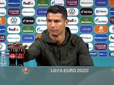 Cristiano Ronaldo removed bottles of Coca-Cola from sight during his press conference (YouTube/ BeanymanSports)