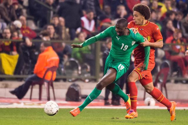 FILE - In this March 5, 2014, file photo, Belgium's Axel Witsel, right, challenges Ivory Coast's Yaya Toure during a friendly soccer match at the King Baudouin stadium in Brussels. The Elephants had a comfortable qualification run under French coach Sabri Lamouchi, with a team filled with Europe-based talent including Manchester City's Yaya Toure. (AP Photo/Geert Vanden Wijngaert,File)