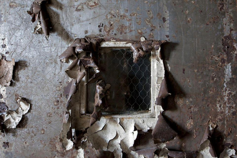 <p>We dare you to take a closer look at what lies beyond this decaying door.</p>