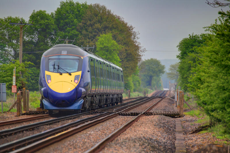 A fast train heading out of Ashford in Kent.