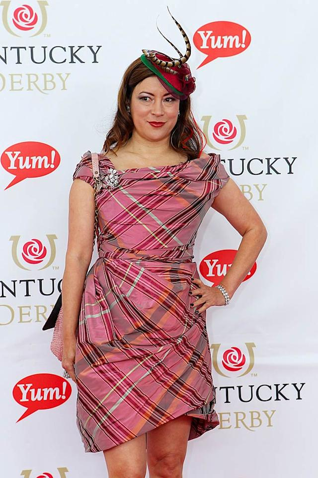 "Actress Jennifer Tilly just had too much going on, from her pink plaid dress and her diamond-encrusted pink handbag, to her eccentric red hat that left what looked liked snakes slithering out of her head. Yikes! Michael Hickey/<a href=""http://www.wireimage.com"" target=""new"">WireImage.com</a> - May 7, 2011"