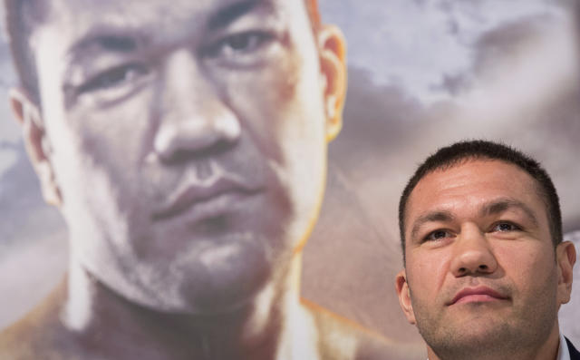 FILE - In this March 15, 2016, file photo, Bulgarian heavyweight boxer Kubrat Pulev attends a news conference in Hamburg, Germany. Officials on Monday, July 22, 2019, lifted the suspension of Pulev who kissed a reporter without her consent during a post-fight interview after he completed a sexual harassment course and paid a $2,500 fine. The California State Athletic Commission voted unanimously to allow Pulev to reapply for his license with the caveat that future offenses would result in a lifetime ban from fighting in North America. (Christian Charisius/dpa via AP, File)