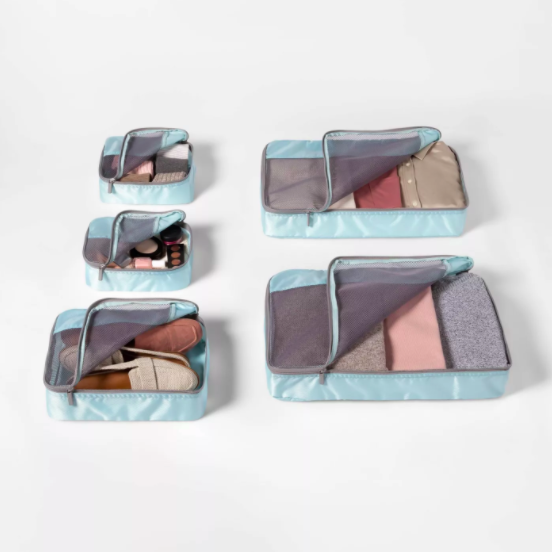 """<h2>Made By Design Packing Cubes</h2><br>A life changer for your favorite traveler.<br><br><strong>Made By Design</strong> 5pc Packing Cube Set - Made By Design™, $, available at <a href=""""https://go.skimresources.com/?id=30283X879131&url=https%3A%2F%2Fwww.target.com%2Fp%2F5pc-packing-cube-set-light-blue-made-by-design-8482%2F-%2FA-77678228"""" rel=""""nofollow noopener"""" target=""""_blank"""" data-ylk=""""slk:Target"""" class=""""link rapid-noclick-resp"""">Target</a>"""