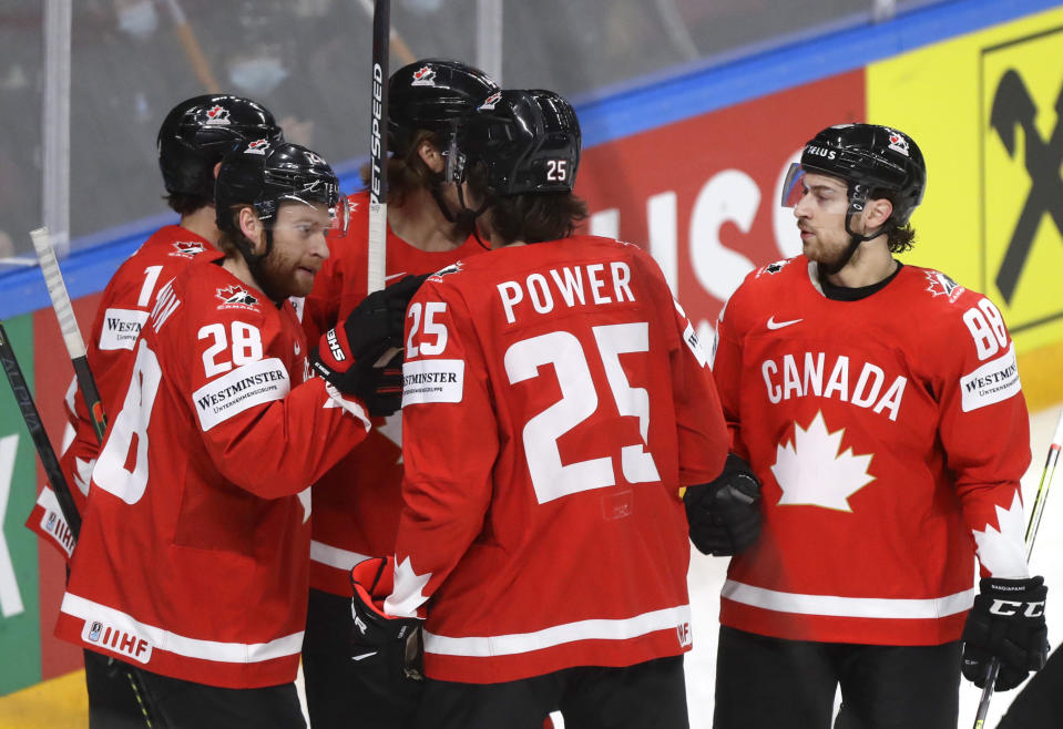 Canada's players celebrate after Canada's Adam Henrique scored his side's second goal during the Ice Hockey World Championship group B match between Canada and Norway at the Arena in Riga, Latvia, Wednesday, May 26, 2021. (AP Photo/Sergei Grits)
