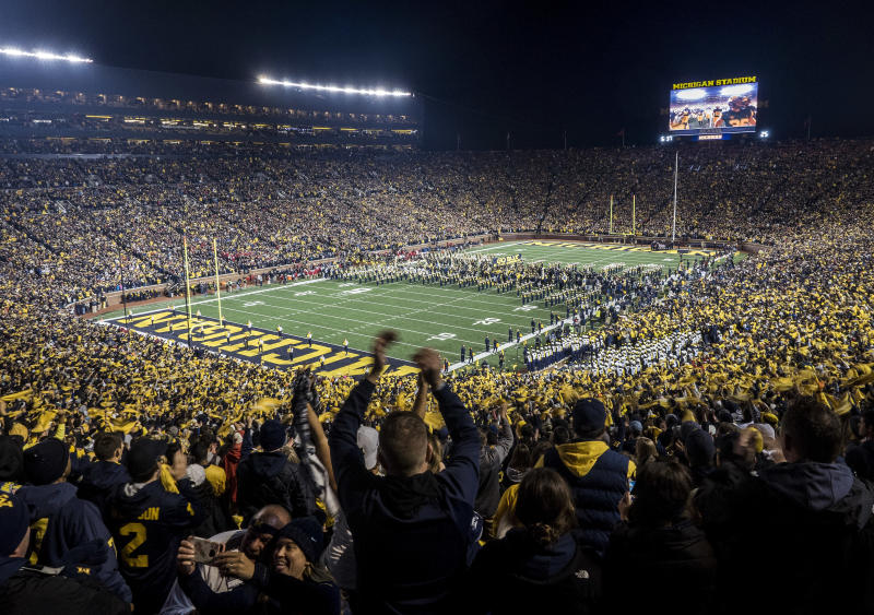 Two people were arrested after allegedly flying a drone over Michigan Stadium during their season opener against Middle Tennessee State on Saturday.