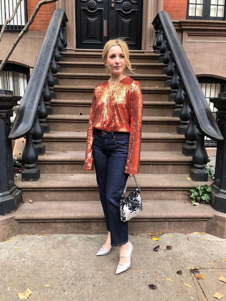 """Head-to-toe sequins are a holiday favorite—and squarely in high-wattage territory, but hear me out: With jeans, this sequined top from <a href=""""https://fave.co/348EYnT"""" rel=""""nofollow"""" target=""""_blank"""">Galvan</a>, shimmering bag from <a href=""""https://fave.co/2PFdSzu"""" rel=""""nofollow"""" target=""""_blank"""">Jimmy Choo</a>, and glittery kitten heels from <a href=""""https://fave.co/2E57lca"""" rel=""""nofollow"""" target=""""_blank"""">Malone Souliers</a> feel low-key sophisticated. Yes, technically it's triple sequins, but when worn with dark-rinse jeans, like mine from <a href=""""https://shop.nordstrom.com/s/khaite-wendell-wide-leg-crop-jeans-stoned-black/5137351/lite?country=US&currency=USD&&mrkgcl=760&mrkgadid=3313967772&utm_content=9383302673&utm_term=pla-314712779186&utm_channel=shopping_ret_p&sp_source=google&sp_campaign=645528200&rkg_id=0&adpos=1o5&creative=57184969553&device=c&matchtype=&network=g&gclid=EAIaIQobChMIvpqYw6qu5gIVCoeGCh1B_QF2EAQYBSABEgJ_YPD_BwE&gclsrc=aw.ds"""" rel=""""nofollow"""" target=""""_blank"""">Khaite</a>, these glimmering pieces convey the spirit of the season without being so in-your-face. I nixed the rhinestone drop earrings for geometric ones."""