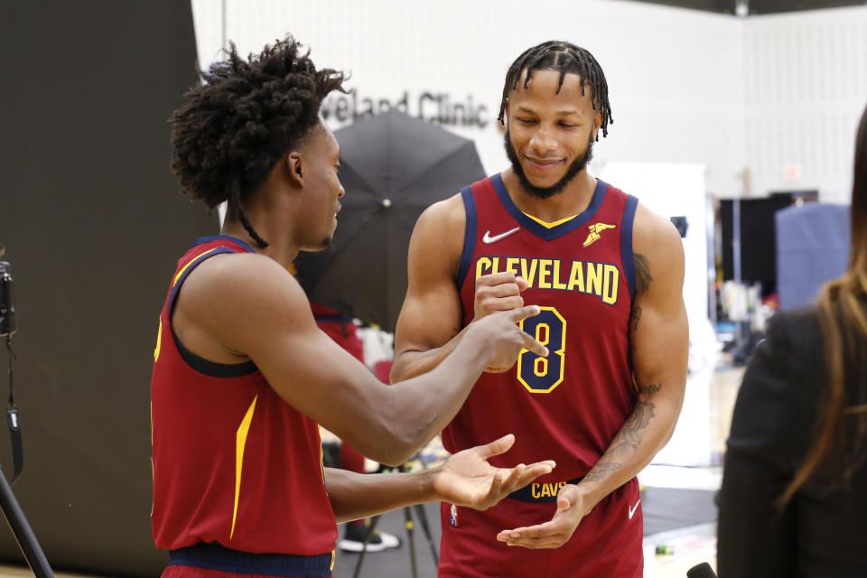 Cleveland Cavaliers' Collin Sexton, left, and Lamar Stevens play a game of rock paper scissors during the NBA basketball team's media day, Monday, Sept. 27, 2021, in Independence, Ohio. (AP Photo/Ron Schwane)