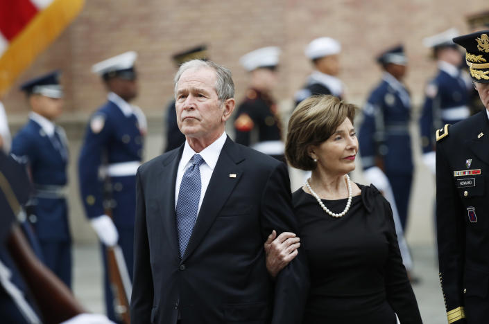 Former President George W. Bush and his wife, Laura Bush, leave St. Martin's Episcopal Church in Houston after the funeral service for his father, former President George H.W. Bush on Thursday, Dec. 6, 2018. (Photo: Gerald Herbert/AP)