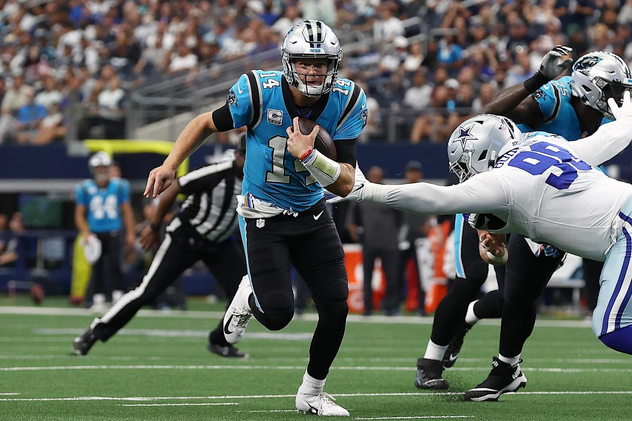 ARLINGTON, TEXAS - OCTOBER 03: Sam Darnold #14 of the Carolina Panthers scrambles and runs passed Quinton Bohanna #98 of the Dallas Cowboys for a touchdown during the second quarter at AT&T Stadium on October 03, 2021 in Arlington, Texas. (Photo by Tom Pennington/Getty Images)