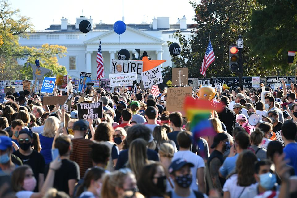 People celebrate on Black Lives Matter plaza across from the White House in Washington, DC on November 7, 2020. Source: Getty