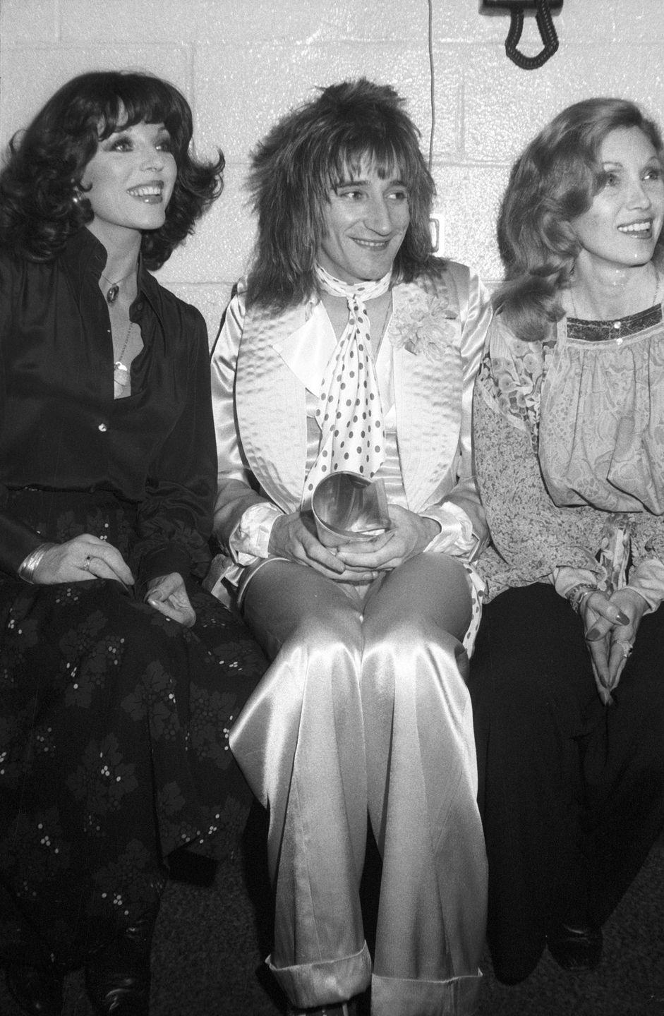 <p>Joan Collins and Alison Steele join rocker Rod Stewart backstage at Madison Square Garden after a Faces show in 1975. Stewart left the rock group later that year. </p>