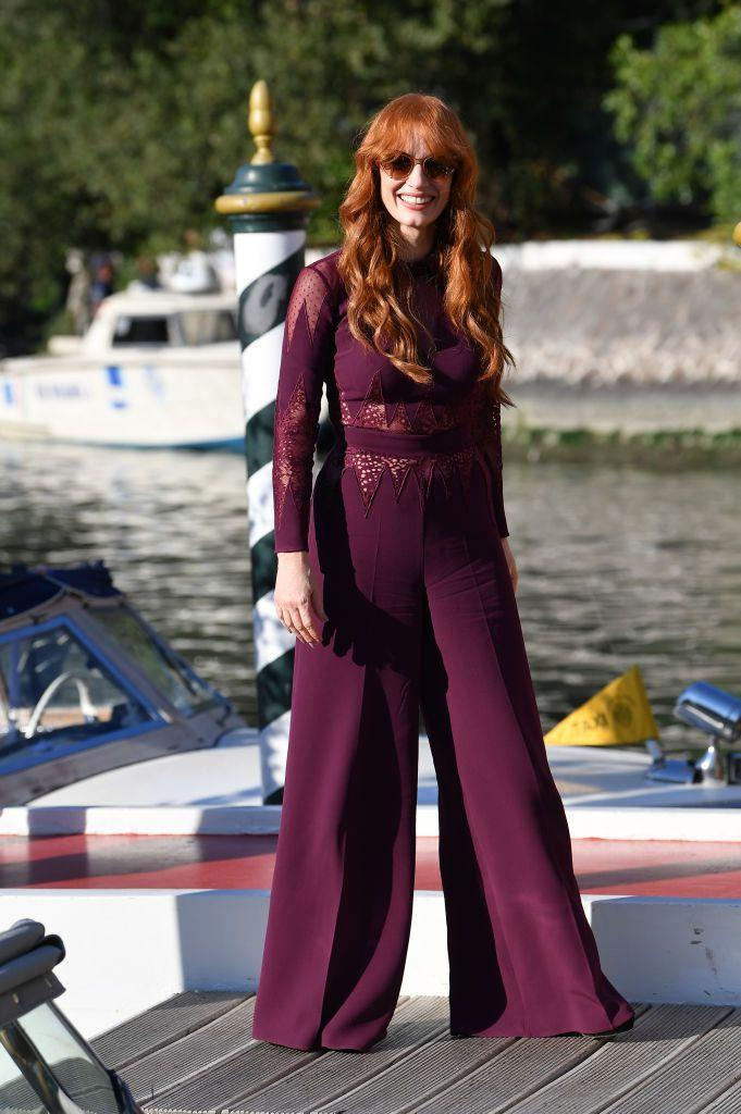 <p>The redhead wore and aubergine purple jumpsuit by Zuhair Murad to arrive at the film festival. </p>