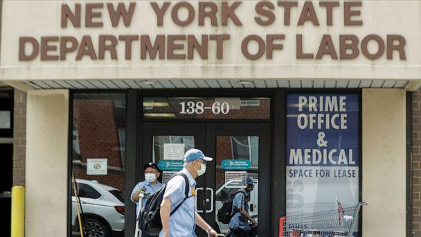 PHOTO:Pedestrians pass an office location for the New York State Department of Labor, June 11, 2020, in New York. (Frank Franklin Ii/AP)
