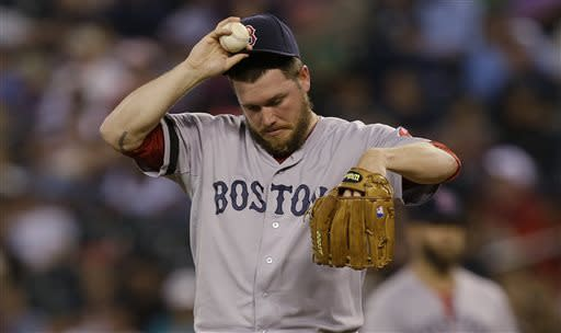 Boston Red Sox pitcher Alex Wilson reacts in the sixth inning of a baseball game after giving up a two-run double to Seattle Mariners Michael Saunders, Monday, July 8, 2013, in Seattle. (AP Photo/Ted S. Warren)