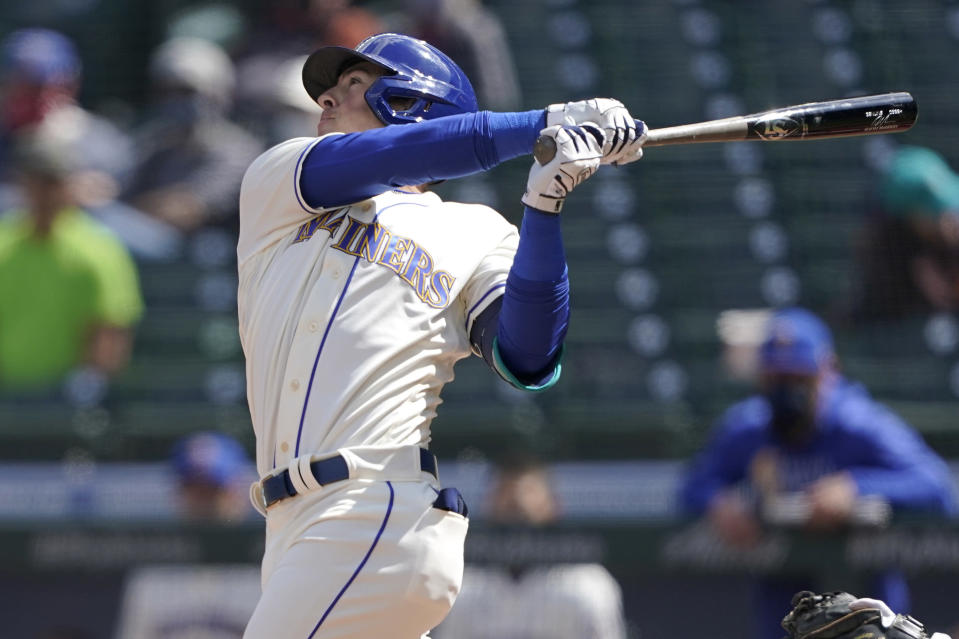 Seattle Mariners' Dylan Moore hits an RBI single to score Kyle Seager in the fourth inning of a baseball game against the Los Angeles Angels, Sunday, May 2, 2021, in Seattle. (AP Photo/Ted S. Warren)