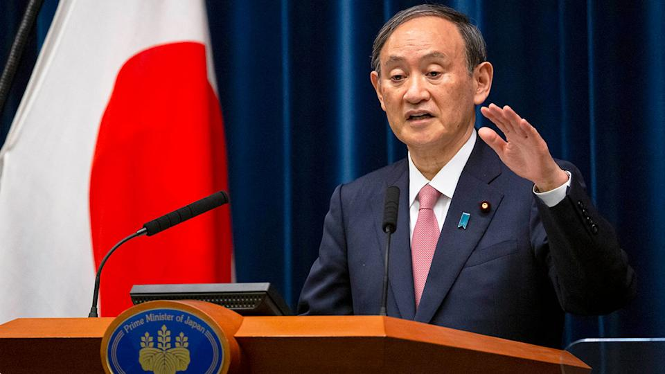 Seen here speaking to the media is Japanese Prime Minister Yoshihide Suga.