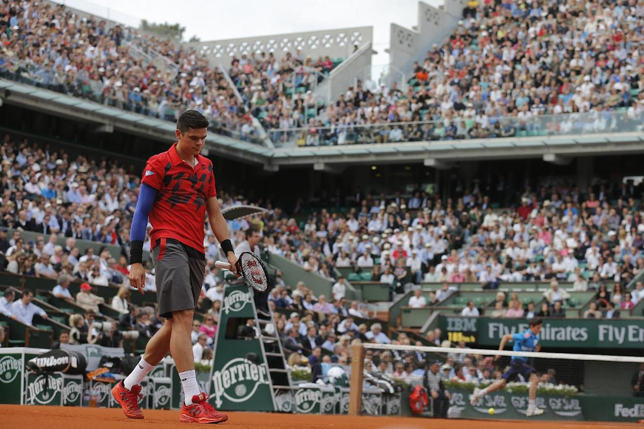 Canada's Milos Raonic walks back to the baseline after missing a return during the quarterfinal match of the French Open tennis tournament against Serbia's Novak Djokovic at the Roland Garros stadium, in Paris, France, Tuesday, June 3, 2014.  (AP Photo/Michel Spingler)