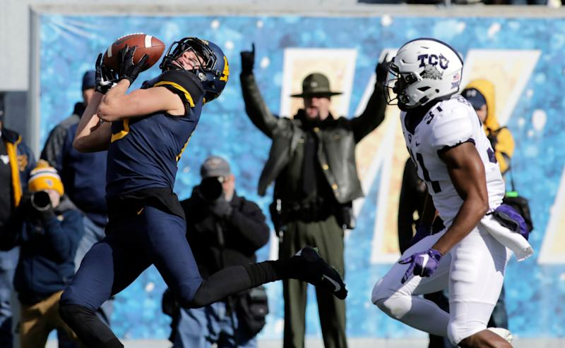 West Virginia wide receiver David Sills V (13) misses a catch while being defended by TCU safety Ridwan Issahaku (31) during the first half of an NCAA college football game Saturday, Nov. 10, 2018, in Morgantown, W.Va. (AP Photo/Raymond Thompson)