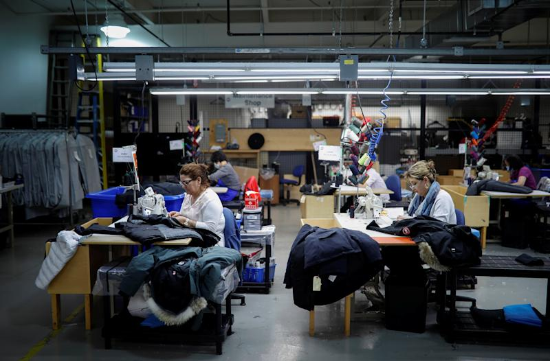 Workers make jackets at the Canada Goose factory in Toronto, Ontario, Canada, February 23, 2018. REUTERS/Mark Blinch