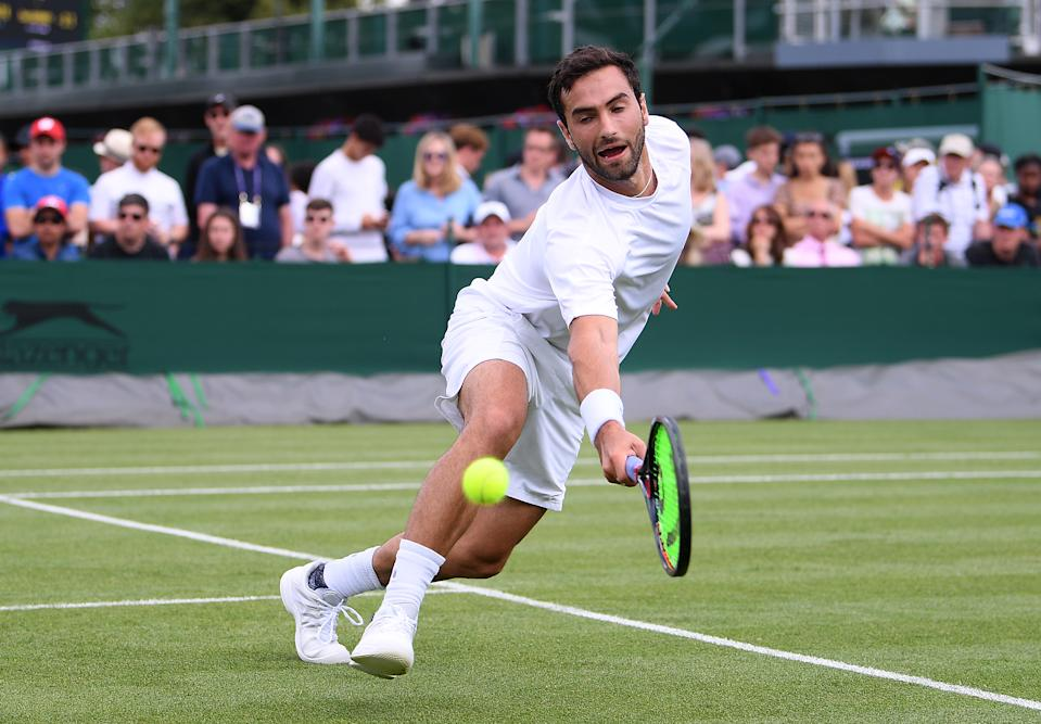 Noah Rubin of the United States plays a backhand in his Men's Singles first round match against Jay Clarke of Great Britain during Day two of The Championships - Wimbledon 2019 at All England Lawn Tennis and Croquet Club on July 02, 2019 in London, England. (Photo by Laurence Griffiths/Getty Images)