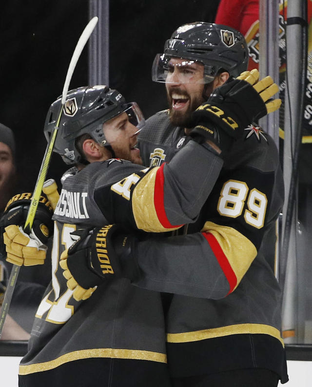 FILE - In this May 4, 2018, file photo, Vegas Golden Knights center Jonathan Marchessault, left, congratulates right wing Alex Tuch (89) on his goal against the San Jose Sharks during the second period of Game 5 of an NHL hockey second-round playoff series in Las Vegas. Tuch, who turned 22 on Thursday, May 10, 2018, has four goals and three assists this postseason as the sole rookie for the expansion Vegas Golden Knights. (AP Photo/John Locher, File)