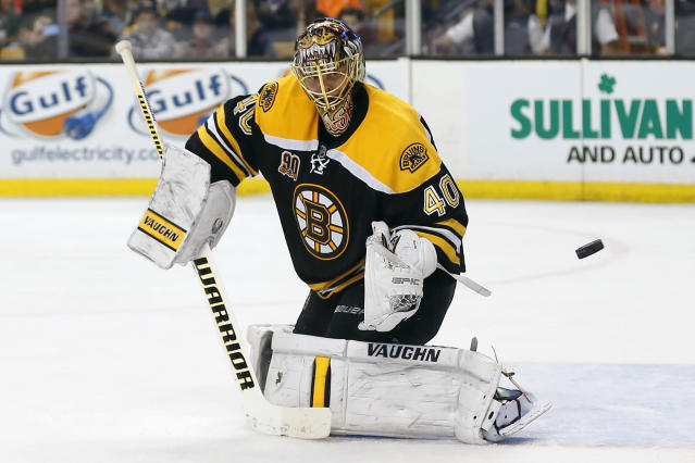 Boston Bruins goalie Tuukka Rask makes a save against the Detroit Red Wings during the third period of Boston's 4-1 win in Game 2 of a first-round NHL hockey playoff series in Boston Sunday, April 20, 2014. (AP Photo/Winslow Townson)