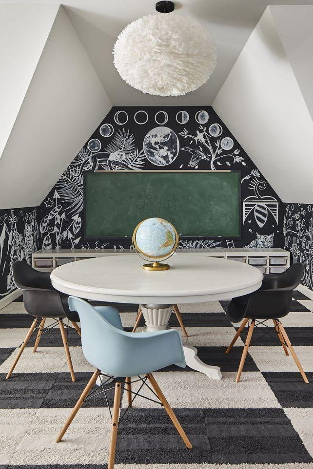<p>With a study area this chic, your kids won't have any issues tackling their homework assignments. This striking design scheme, featuring black-and-white carpeting and a chalkboard accent wall, is guaranteed to help maintain their focus and let their imagination run wild. </p>