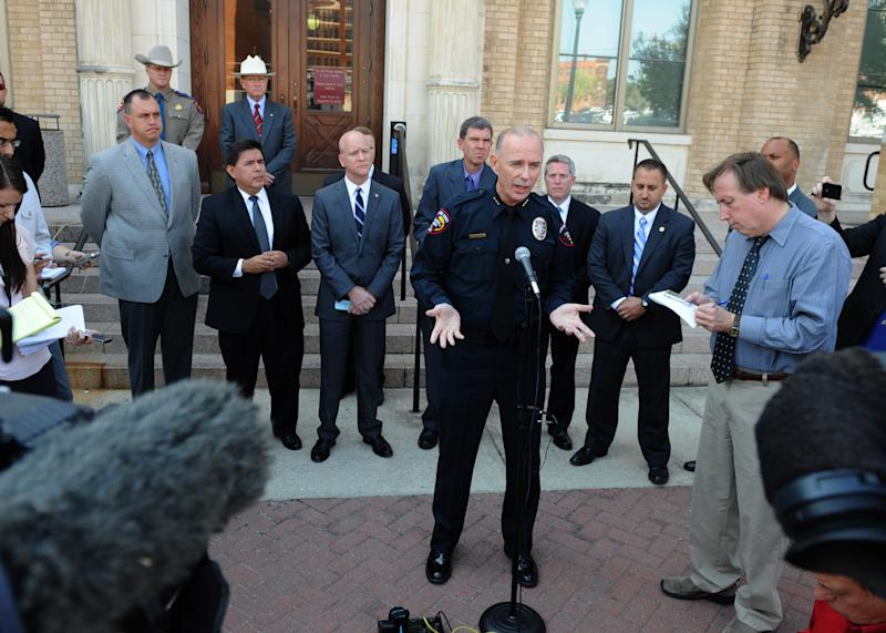 """Killeen police chief Dennis Baldwin, center, talks with reporters outside the federal courthouse in Waco, Texas after Army Pfc. Naser Jason Abdo was sentenced to two consecutive life terms in prison Friday, Aug. 10, 2012. Abdo, an AWOL soldier , convicted for collecting bomb-making materials to carry out what he told authorities would be a """"massive attack"""" on a Texas restaurant full of Fort Hood troops. (AP Photo/Waco Tribune Herald, Rod Aydelotte)"""