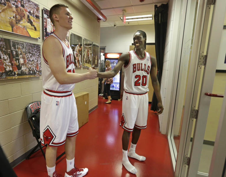 Chicago Bulls NBA basketball draft picks Erik Murphy, left, and Tony Snell, meet in the hallway at the Berto Center Monday, July 1, 2013, in Deerfield, Ill., after changing into their new uniforms for the first time. The Bulls selected Snell with the 20th pick out of New Mexico, and Murphy with the 49th pick out of Florida. (AP Photo/M. Spencer Green)