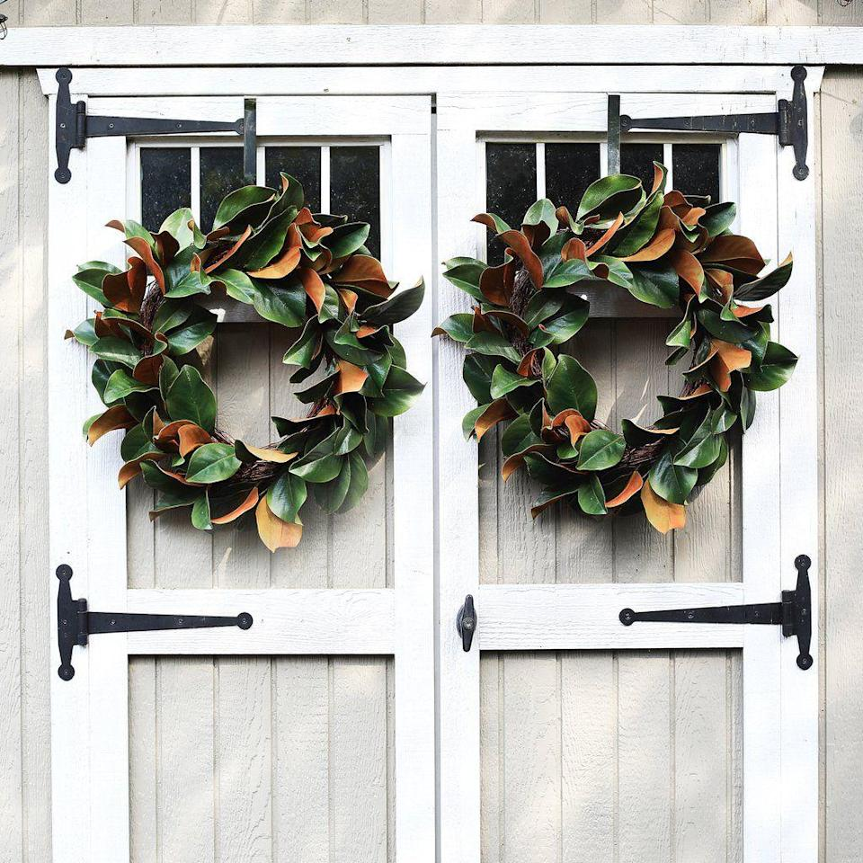 "<p>Darby Creek Trading</p><p><strong>$149.00</strong></p><p><a href=""https://darbycreektrading.com/products/classic-real-touch-magnolia-leaf-everyday-greenery-spring-wreath"" rel=""nofollow noopener"" target=""_blank"" data-ylk=""slk:Shop It"" class=""link rapid-noclick-resp"">Shop It</a></p><p>Magnolia wreaths don't have to only be for Christmas. A simple one looks beautiful all throughout the fall and is easy to make more festive when the holidays roll around.</p>"