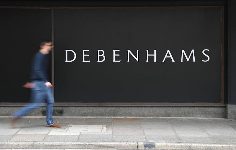 A person walks past a Debenhams department store in Southsea, Hampshire, which has been named as one of 22 stores to be closed, putting 1,200 jobs at risk across the department store chain. (Photo by Andrew Matthews/PA Images via Getty Images)