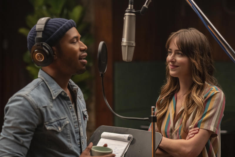 """This image released by Focus Features shows Kelvin Harrison Jr., left, and Dakota Johnson in a scene from """"The High Note.""""  (Glen Wilson/Focus Features via AP)"""