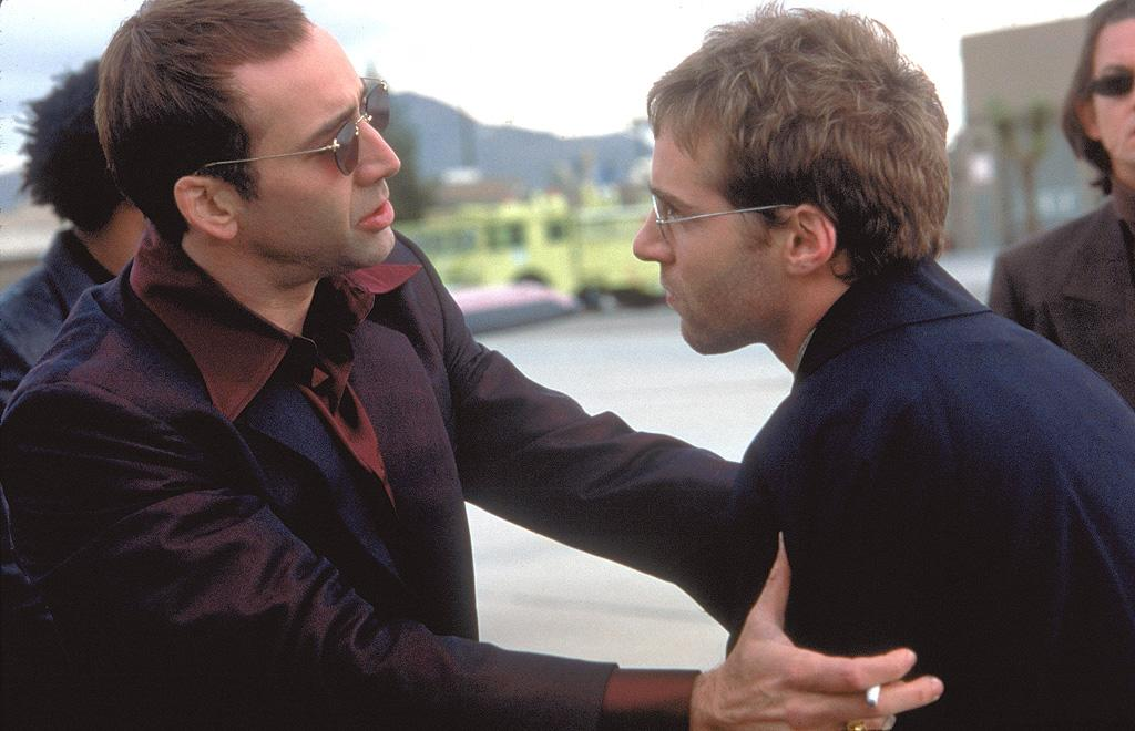 """<a href=""""http://movies.yahoo.com/movie/1800021618/info"""">FACE/OFF</a> -- The Skeezy Caeser    Cage sports a lid so improbable that it makes the rest of <a href=""""http://movies.yahoo.com/movie/contributor/1800021620"""">John Woo</a>'s film look like gritty realism."""