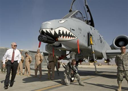 """US Secretary of Defense Gates greets the crew and looks over an A-10 """"Warthog"""" during an unannounced visit to Bagram Airfield"""