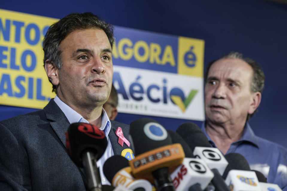 Aecio Neves, Brazil's presidential candidate speaks during a press conference with Aloysio Nunes (Neves' vice-president candidate). Sao Paulo, Brazil, October 6th 2014. (Photo by Paulo Fridman/Corbis via Getty Images)