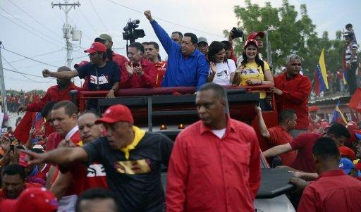 Venezuelan President Hugo Chavez waves to supporters during a campaign rally in Cabimas, on September 30. The leftist leader, in power for almost 14 years, is vying for a fourth term in office that would extend his presidency by another six years, but opposition candidate Henrique Capriles hopes to pull a major upset on October 7