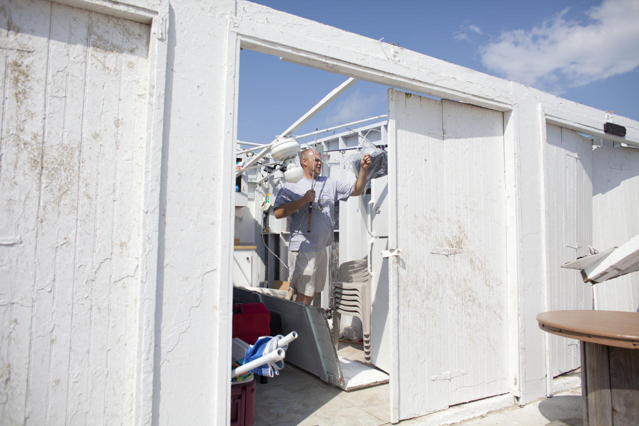 NEW YORK, NY - SEPTEMBER 8: Danny Fallon of Brooklyn, New York inspects the damage in his rental cabana where a tornado touched down on September 8, 2012 in the Breezy Point neighborhood of the Queens borough of New York City. The National Weather Service has issued a tornado watch as severe weather continues to move through New York metro area. (Photo by Ramin Talaie/Getty Images)