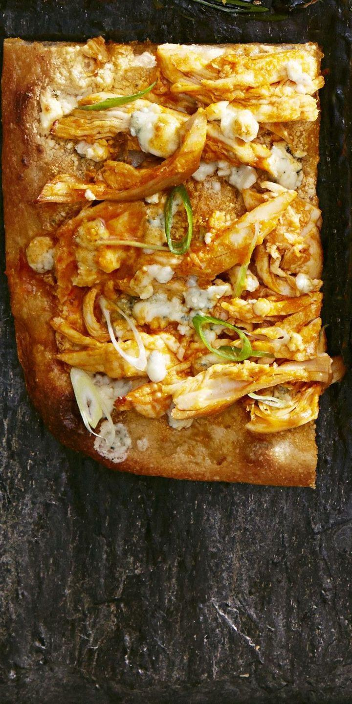 """<p>Pizza is a clear favorite when it comes to game-day noshing, and this one has all the classic flavors of buffalo chicken wings. Touchdown.</p><p><a href=""""https://www.goodhousekeeping.com/food-recipes/easy/a36230/buffalo-chicken-ranch-pizza/"""" rel=""""nofollow noopener"""" target=""""_blank"""" data-ylk=""""slk:Get the recipe for Buffalo Chicken and Ranch Pizza »"""" class=""""link rapid-noclick-resp""""><em>Get the recipe for Buffalo Chicken and Ranch Pizza »</em></a></p>"""