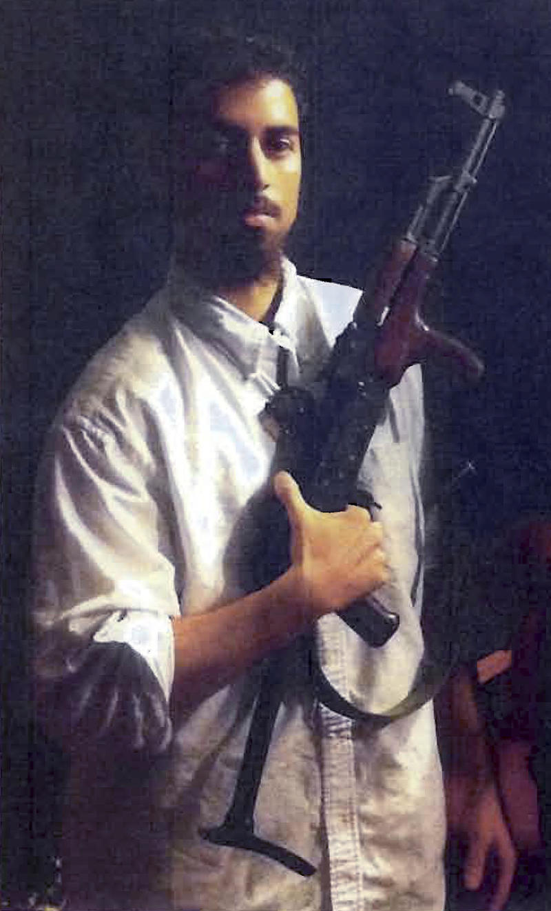 This section of an undated photo released by the U.S. Attorney's Office, which had been presented as a government Aexhibit at a 2011 hearing, shows Rezwan Ferdaus, of Ashland, Mass.  Court documents filed Tuesday, July 10, 2012 said Ferdaus, who is charged with plotting to fly remote-controlled model planes packed with explosives into the Pentagon and U.S. Capitol, plans to plead guilty to two charges on July 20, 2012 in federal court in Boston.  (AP Photo/U.S. Attorney's Office)