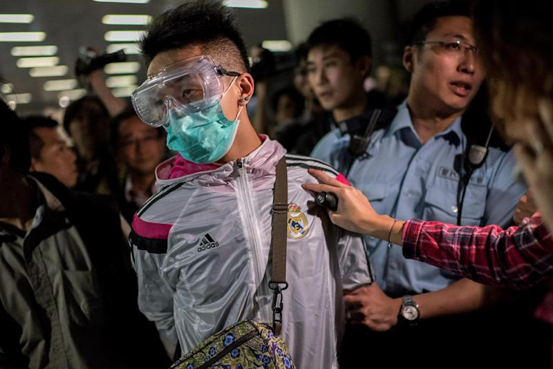 Police detain a man as pro-democracy protesters faced-off with police outside the central government offices in the Admiralty district of Hong Kong on November 19, 2014 (AFP Photo/Alex Ogle)