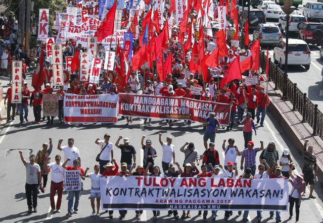<p>Protesters, mostly workers march towards the Presidential Palace during the global commemoration of Labor Day, May 1, 2018 in Manila, Philippines. About 5,000 workers and activists from various groups held a rally Tuesday near the Malacanang Palace to protest the failure of Philippine President Rodrigo Duterte to fulfill a major campaign promise to end contractualization, the widespread practice of short-term employment. (Photo: Bullit Marquez/AP) </p>