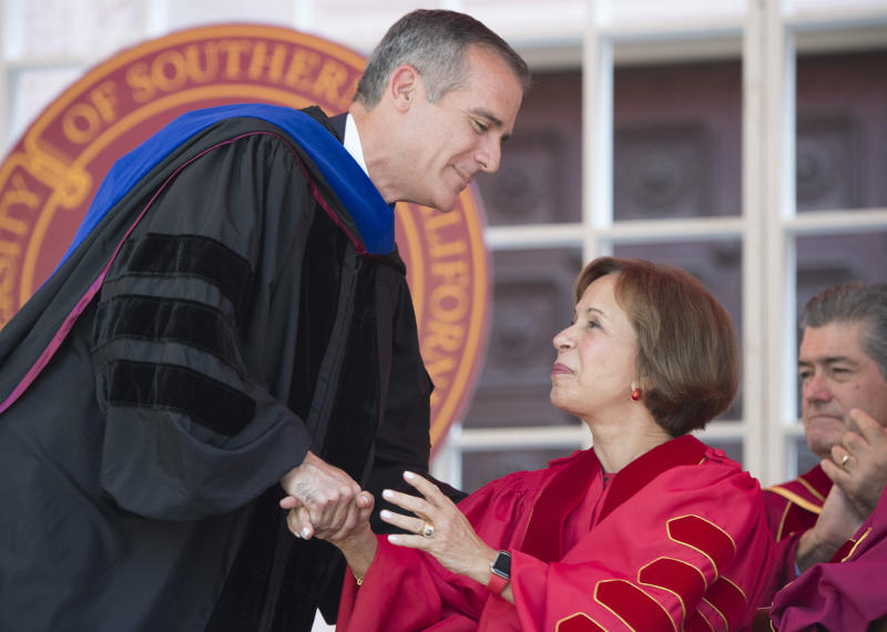 IMAGE DISTRIBUTED FOR USC -  Los Angeles Mayor Eric Garcetti, left, congratulates USC President Carol L. Folt during Folt's inauguration on Friday Sept. 20, 2019 in Los Angeles. (Phil McCarten/AP Images for USC)